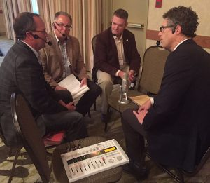 Recording the podcast live at Canola Discovery Forum. Credit: Rick Taillieu
