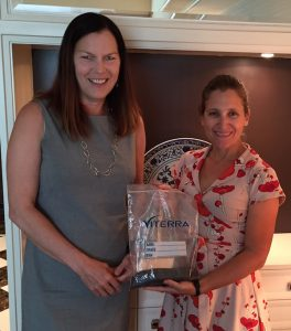 CCC President Patti Miller (l) and MP Chrystia Freeland in China with canola from Freeland's father's farm in Alberta.