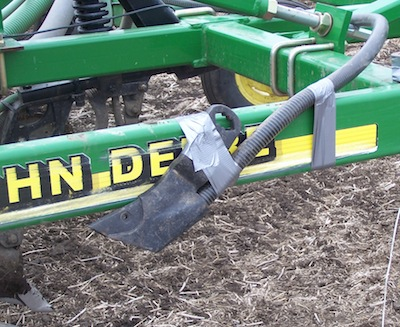 If you can remove openers and hose assembly from the shank, tape it to the side of the frame. Then attach a bag or sock around the end, as shown in photo 2.