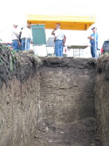 Ross McKenzie used freshly-dug soil pits to demonstrate how soil changes with depth.