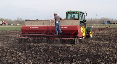 Team CROP also chose the disc drill. Curtis Cavers makes sure seed is flowing properly.